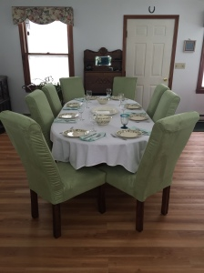Tuxedo Chairs first reupholstered in a muslin/ticking  and Lime green ultra suede slipcovers removable for laundering!